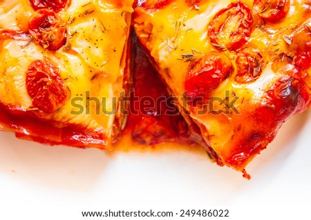 Homemade Fresh Lasagna topped with Melted Cheese and Tomato, Oven Baked, Italian Cuisine, Serve on Dish with tomato gravy sauce / Home Cooking Food Delicious. Close up  - stock photo