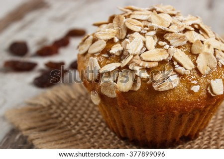 Homemade fresh muffin with oatmeal baked with wholemeal flour and raisins, concept of delicious, healthy dessert or snack - stock photo