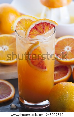 Homemade freshly squeezed orange juice with ice. - stock photo