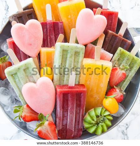 Homemade frozen ice cream popsicles in various flavors - stock photo