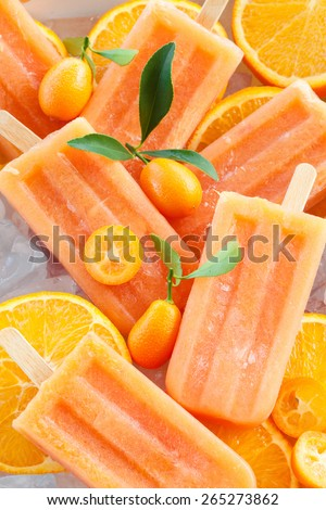 Homemade frozen popsicles made with oragnic fresh oranges - stock photo