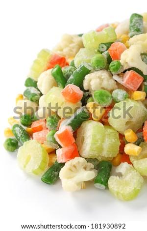 homemade frozen vegetables on white background - stock photo