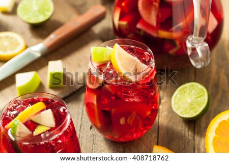 Homemade Fruity Spanish Red Sangria with Apples and Citrus - stock photo