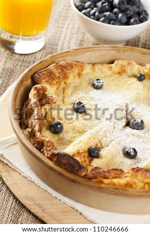 Homemade German Pancake with blueberries on a background