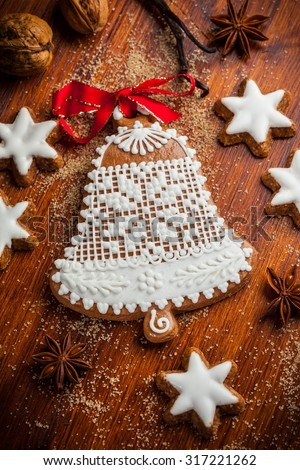 Homemade gingerbread bell for Christmas with baking ingredients - stock photo