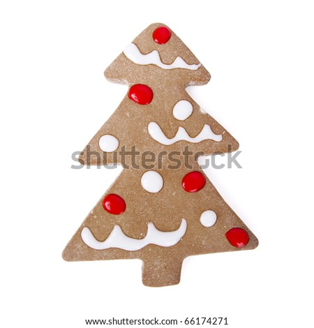 Homemade Gingerbread christmas cookies with a shape of a tree isolated on white