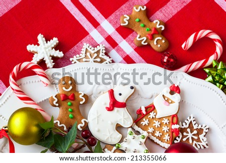 Homemade gingerbread cookies  and candies on a plate - stock photo