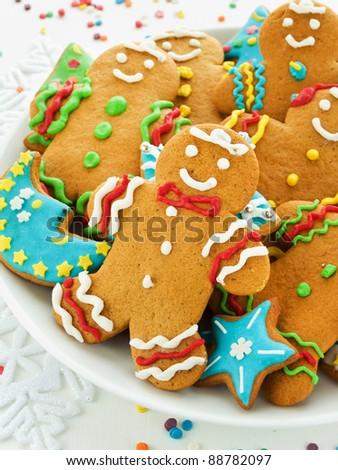 Homemade gingerbread cookies with colored icing. Shallow dof. - stock photo
