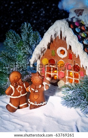 Homemade gingerbread house at night - stock photo
