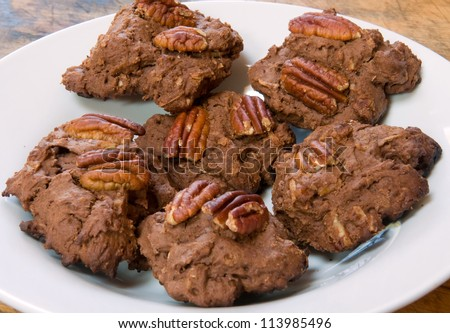 Homemade gluten-free chocolate pecan drop cookies on a plate - made with gluten-free flour - stock photo
