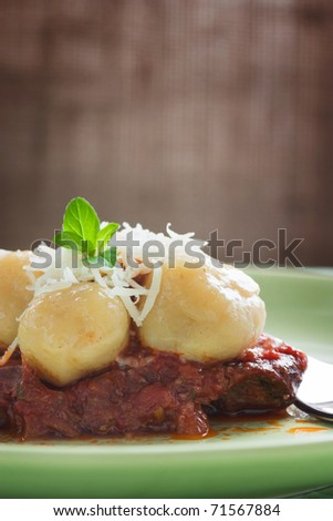 Homemade gnocchi with beef and tomato sauce - stock photo