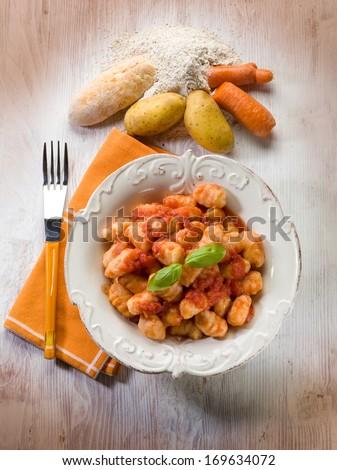 homemade gnocchi with tomato sauce  - stock photo