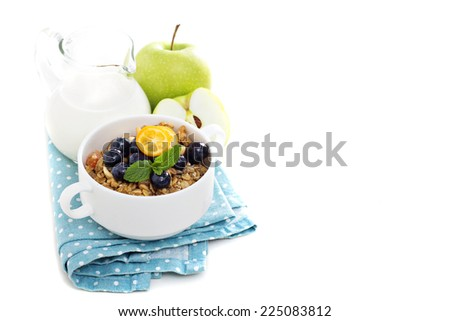 Homemade granola with milk and fresh apple for breakfast isolated on white - stock photo