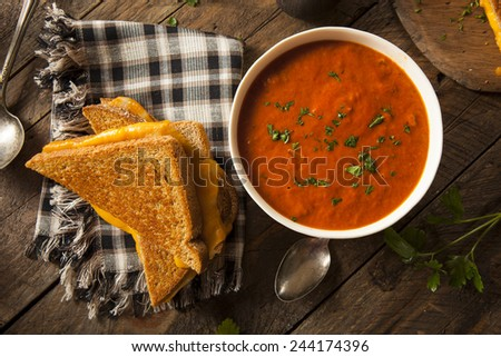 Homemade Grilled Cheese with Tomato Soup for Lunch - stock photo