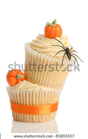 Homemade Halloween pumpkin cupcakes on white background for trick or treat night - stock photo