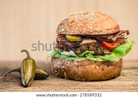 homemade hamburger with fresh vegetables and Jalapeno pepper - stock photo