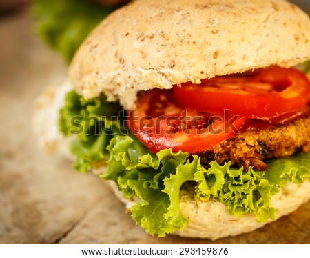 Homemade Healthy Vegetarian Quinoa Burger with Lettuce and Tomato