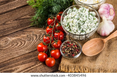Homemade Herb Curd in bowl (close-up shot) on vintage wooden background - stock photo