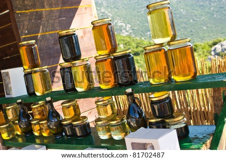 Homemade honey on the street market in Croatian mountains - stock photo