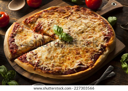 Homemade Hot Cheese Pizza with Basil and Mozzarella - stock photo