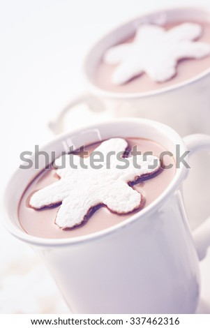 Homemade hot chocolate garnished with snowflake shaped white marshmallows.