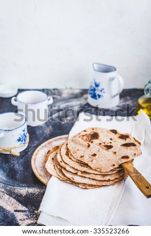 Homemade Indian Naan Flatbread made with Whole Wheat flour. Homemade tortilla concept. Rustic style.  - stock photo
