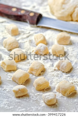 Homemade italian gnocchi on  kitchen table - stock photo