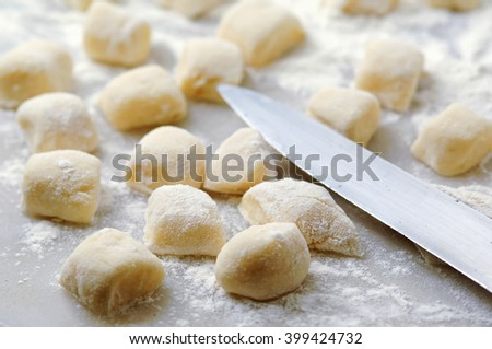 Homemade italian gnocchi on kitchen table - stock photo