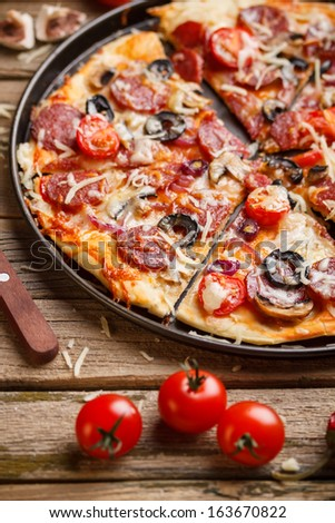 Homemade italian pizza in metal plate - stock photo