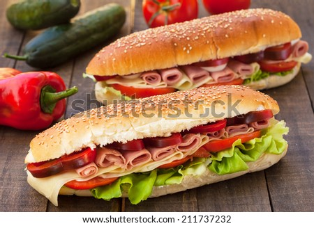 Homemade Italian Sub Sandwich with Salami, Tomato and Lettuce  - stock photo