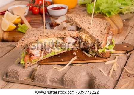 Homemade Leftover Thanksgiving Dinner Sandwich with Roast Meat, Cheese and Vegetables  - stock photo
