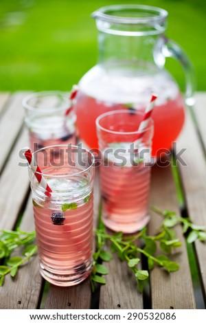 Homemade lemonade made from red berries - stock photo