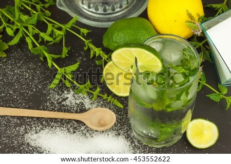 Homemade lemonade with fresh lemon and mint. Cool, refreshing dip in the hot summer. - stock photo