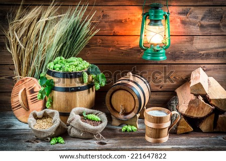 Homemade light beer served in a wooden mug - stock photo