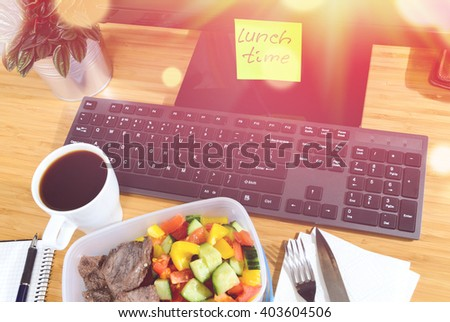 homemade lunch box at modern stylish work place, view from above - stock photo
