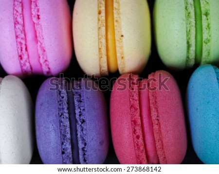Homemade Macaroon on black wooden table - stock photo