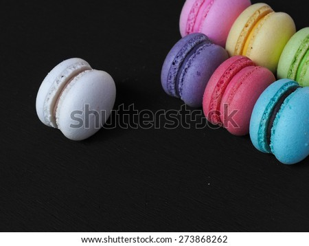 Homemade Macaroon on black wooden table