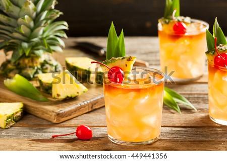 Homemade Mai Tai Cocktail with Pineapple Cherry and Rum - stock photo