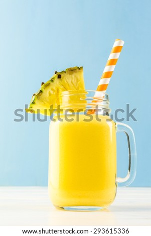 Homemade mango and pineapple smoothie made with coonut milk. - stock photo