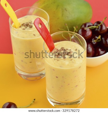 Homemade mango cherry smoothie with flax seeds
