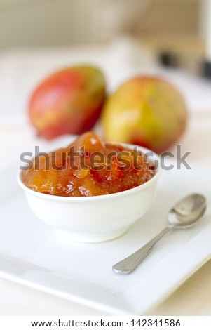 Homemade mango chutney with ginger and red pepper. - stock photo