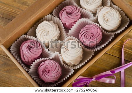 Homemade marshmallow - Zephyr in  box on a rustic wooden table. Top view - stock photo