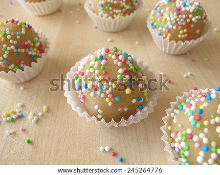 Homemade marzipan pralines with sugar pearls - stock photo