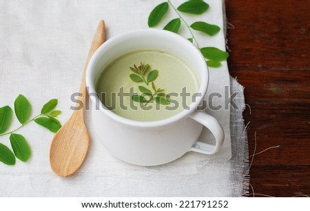 homemade matcha green tea panna cotta in a cup on wooden background. - stock photo