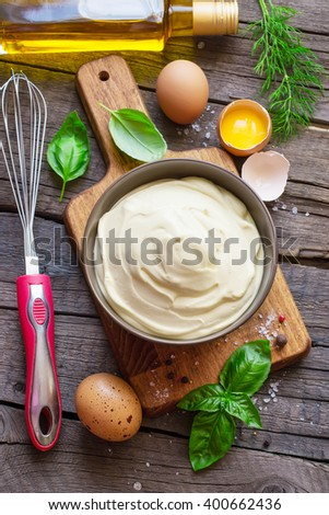 Homemade mayonnaise sauce and ingredients. Top view - stock photo