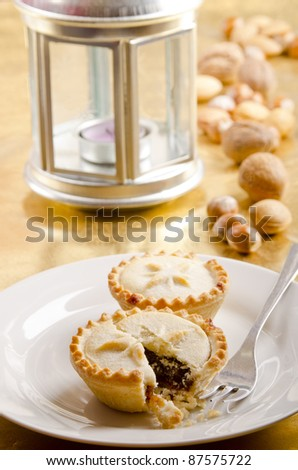 homemade mince pies on a white plate - stock photo