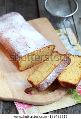 homemade Moist bread with orange juice and zest with the addition of almond flour, Selective focus on slices of cake - stock photo