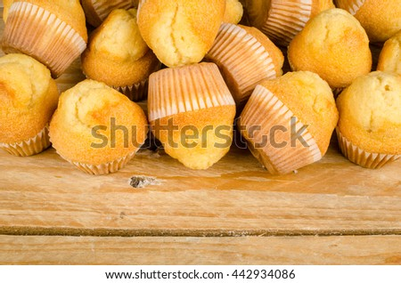 Homemade muffins on a rustic table - stock photo