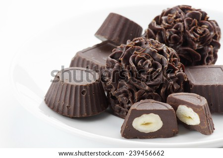 Homemade natural chocolate candies on white background. - stock photo