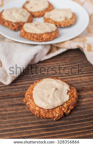 Homemade oat cookies with cream on a wooden table. Selective focus.